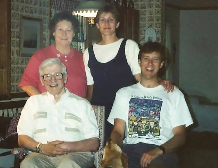 Phillip and I with my parents many years ago.