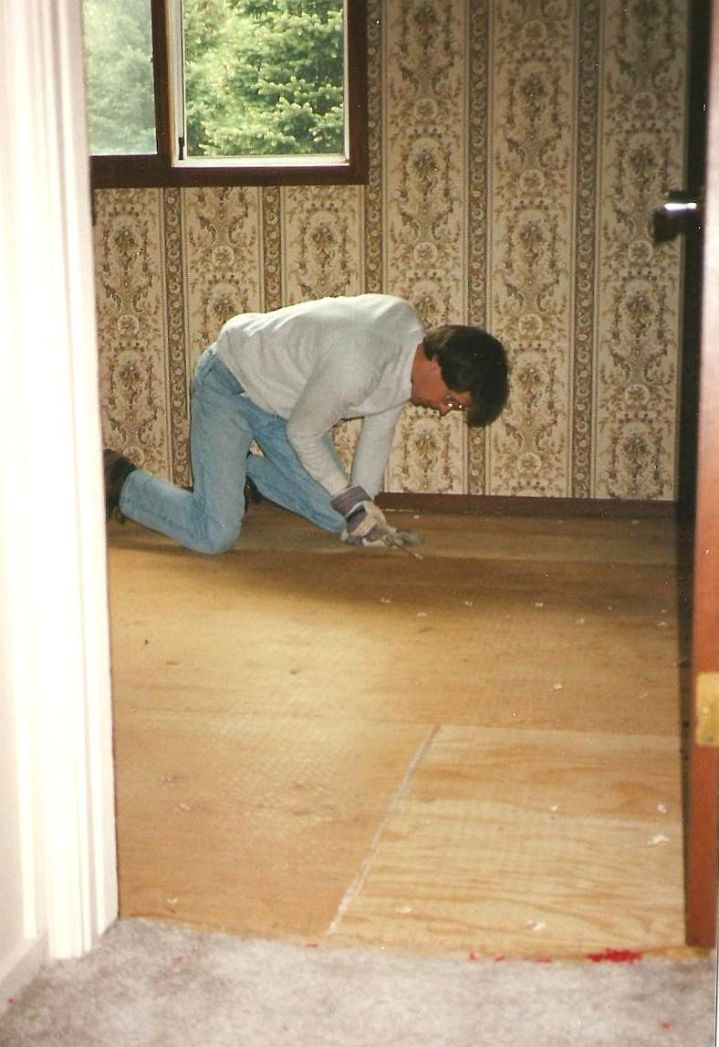 Removing hideous flaming red carpeting before removing hideous wallpaper, windows and doors.